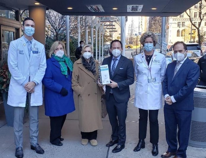 Photo of Rep. Maloney with group while donating masks